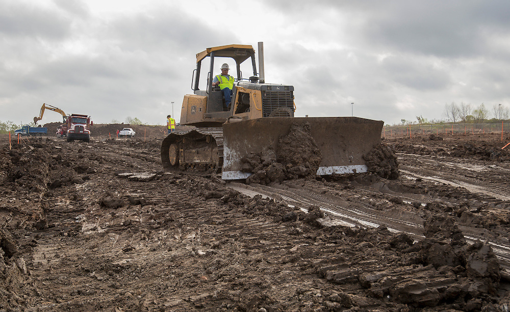 Construction crews work on the site of the new South Early College High School, March 4, 2015.