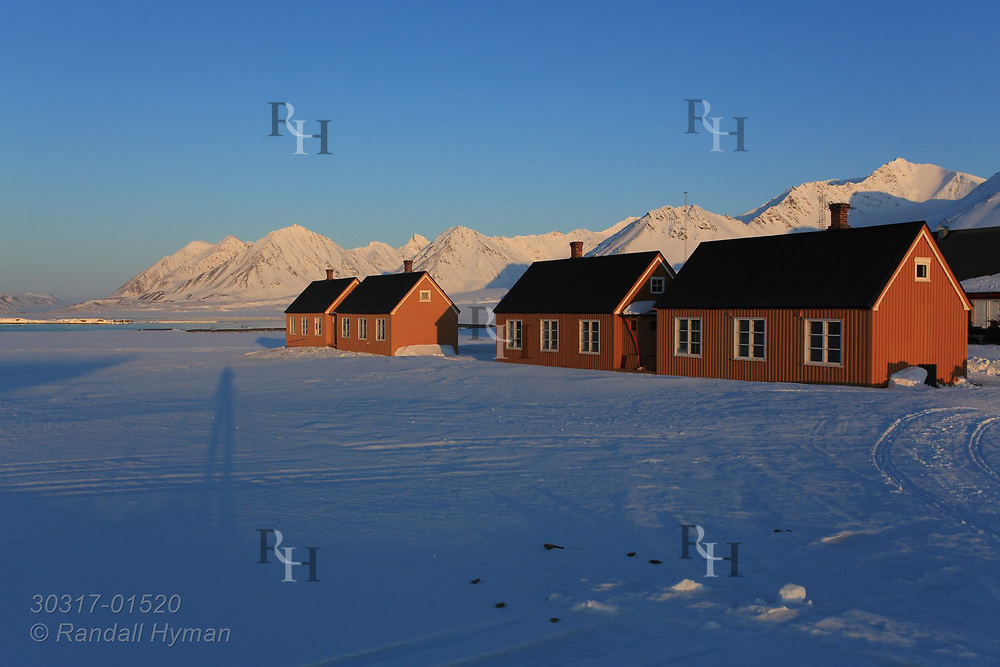 """So-called """"London Houses"""" (moved intact from a British mine across the fjord) are part of the international science village of Ny-Alesund on Spitsbergen island in Kongsfjorden; Svalbard, Norway."""
