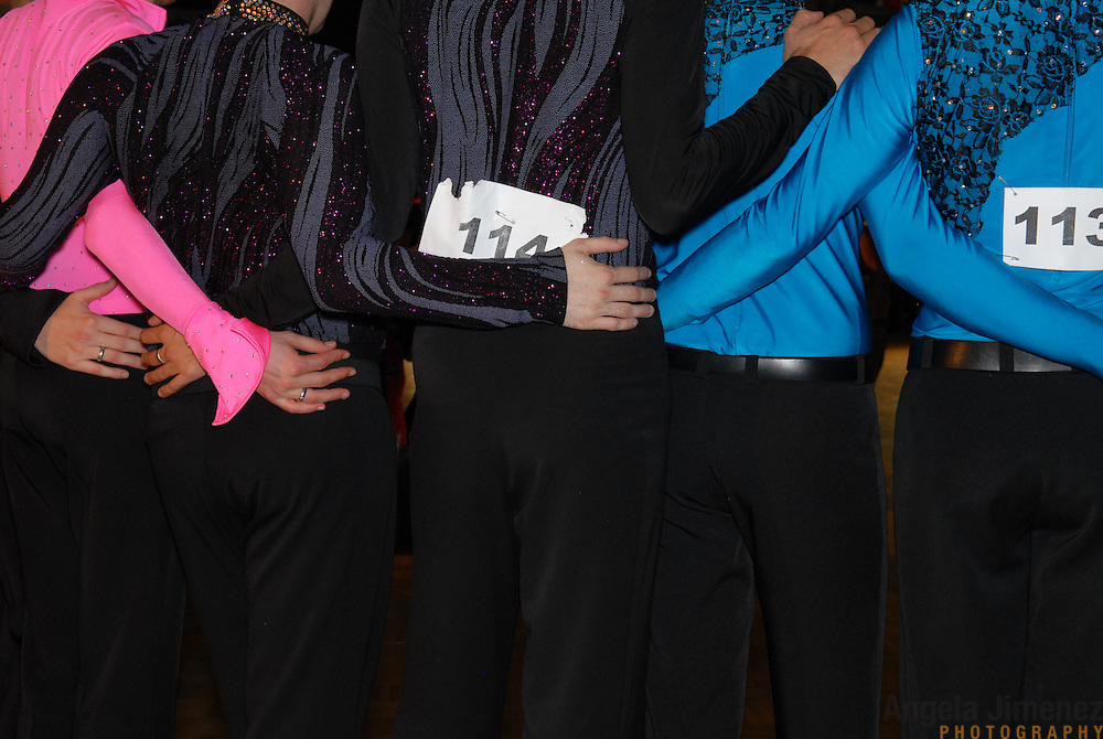 Dancers in the men's latin division put their arms around each other on the medal stand while posing for photos after competing in the same-sex ballroom dancing competition during the 2007 Eurogames at the Waagnatie hangar in Antwerp, Belgium on July 14, 2007. ..Over 3,000 LGBT athletes competed in 11 sports, including same-sex dance, during the 11th annual European gay sporting event. Same-sex ballroom is a growing sports that has been happening in Europe for over two decades.