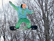 Warwick, New York - A teenager on a snowboard goes airborne during the Big Air competition at the annual Spring Rally at Mount Peter Ski and Ride on March 21, 2010.