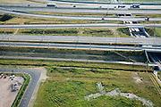 Nederland, Breda, Kruisstraat, 04-07-2006;  infrastructuur bundel: aan de horizon de vernieuwde A16, begin knooppunt Princeville; HSin de voorgrond; op deze lokatie heeft het hoofdspoor van de HStwee verbindingen met het gewone spoor (in- respectievelijk uittakking), richting station Breda; deze verbindingsbogen zullen door shuttle treinen gebruikt gaan worden (van en naar Antwerpen); spoorbanen, viaduct, bovenleiding, viaduct, transport, infrastructuur, verkeer en vervoer, mobiliteit, hogesnelheidslijn, spoor, rail, HSL, TGV, planologie, ruimtelijke ordening, landschap;;zie ook andere foto's van deze lokatie (lucht en panorama); deevan de serie Panorama Nederland; luchtfoto (toeslag); aerial photo (additional fee required); .foto Siebe Swart / photo Siebe Swart