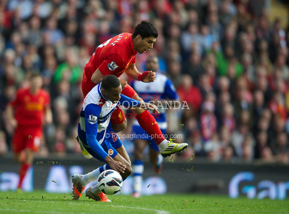 LIVERPOOL, ENGLAND - Saturday, October 20, 2012: Liverpool's Luis Alberto Suarez Diaz is upended by Reading's Shaun Cummings during the Premiership match at Anfield. (Pic by David Rawcliffe/Propaganda)