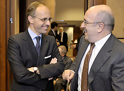 Luc Frieden, Luxembourg's minister of Finance, left, speaks with Joaquin Almunia, The EU's commissioner for economic and monetary affairs, during Eurogroup, the meeting of finance ministers from the sixteen countries that use the Euro as their currency,  at EU Council headquarters in Brussels, Belgium, on Monday, Nov. 9, 2009. (Photo © Jock Fistick)