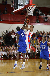 Eastern's Lionell Gaines, left, contests a shot by Scott County's Tamron Manning late in the second half. Easter held the lead to win 66-60.  Scott County hosted Eastern at home Tuesday, Feb. 15, 2011.