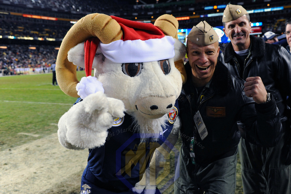 10 December 2011:   The Naval Academy mascot, Bill the Goat stands on the sidelines with Navy pilot Chris Hayle during the game against the Army Black Knights at Fed Ex field in Landover, Md. in the 112th annual Army Navy game where Navy defeated Army, 27-21 for the 10th consecutive time.