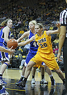 December 20, 2011: Drake Bulldogs forward/center Stephanie Running (44) and Iowa Hawkeyes forward Kelly Krei (20) eye the ball during the NCAA women's basketball game between the Drake Bulldogs and the Iowa Hawkeyes at Carver-Hawkeye Arena in Iowa City, Iowa on Tuesday, December 20, 2011. Iowa defeated Drake 71-46.