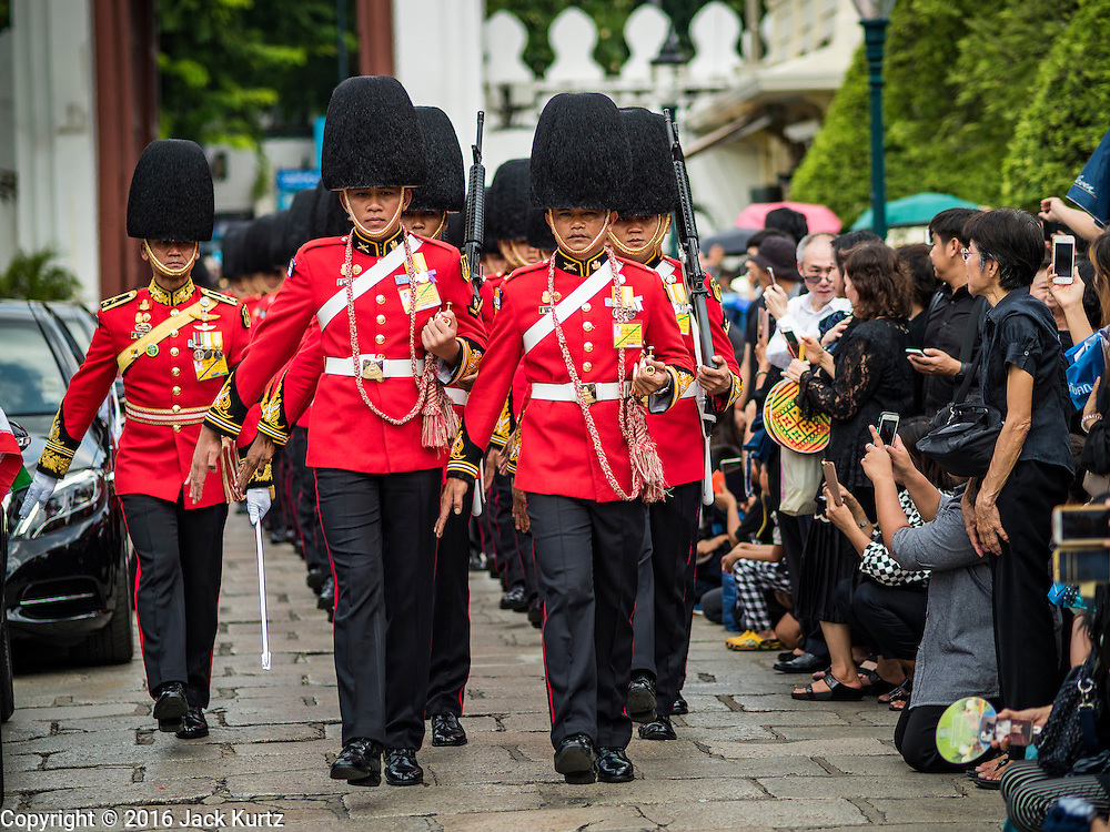 14 OCTOBER 2016 - BANGKOK, THAILAND: A Thai Army Honor Guard marches into the Grand Palace on the first day of mourning Bhumibol Adulyadej, the King of Thailand, who died Oct. 13, 2016. He was 88. His death comes after a period of failing health. With the king's death, the world's longest-reigning monarch is Queen Elizabeth II, who ascended to the British throne in 1952. Bhumibol Adulyadej, was born in Cambridge, MA, on 5 December 1927. He was the ninth monarch of Thailand from the Chakri Dynasty and is known as Rama IX. He became King on June 9, 1946 and served as King of Thailand for 70 years, 126 days. He was, at the time of his death, the world's longest-serving head of state and the longest-reigning monarch in Thai history.     PHOTO BY JACK KURTZ