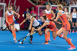 England's Sophie Bray is tackled by Marloes Keetels of The Netherlands. The Netherlands v England - Quarter Final Vitality Hockey Women's World Cup, Lee Valley Hockey and Tennis Centre, London, UK on 02 August 2018. Photo: Simon Parker