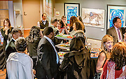 Patrons socializing around one of the appetizer stations at SOPAC's 2016 Gala.