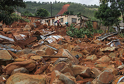 March 23, 2019 - Chimanimani, Zimbabwe - A family search for a missing family member in the rubble and debris surrounding their home in Ngangu Township Chimanimani. According to the U.N. agency at least 259 people were killed in Zimbabwe by Cyclone Idai, and some 217 are still missing. Hundreds of people had been injured and authorities had confirmed that 16,000 households had been displaced, the International Organization said in a statement. (Credit Image: © Tafadzwa Ufumeli/ZUMA Wire)