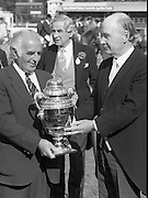Dublin Horse Show (Aga Khan Cup).1986..08.08.1986..08.08.1986..8th August 1986..The annual Aga Khan Cup competition was held in the R.D.S. Dublin.Four countries competed for the cup this year.FDR Germany,The USA,Great Britain and Ireland. Great Britain were the eventual winners...Pictured making the presentation of The Aga Khan cup are President of Ireland,Dr Patrick Hillery and on behalf of the Great Britain team, Mr Ronnie Massarella, Chef d'Equipe. In the background is Mr Frank O'Reilly,Chairman of the RDS Executive Committee.