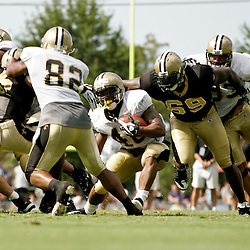 04 August 2009: New Orleans Saints running back Herb Donaldson (40) is caught from behind by defensive end Anthony Hargrove (69) during New Orleans Saints training camp at the team's practice facility in Metairie, Louisiana.