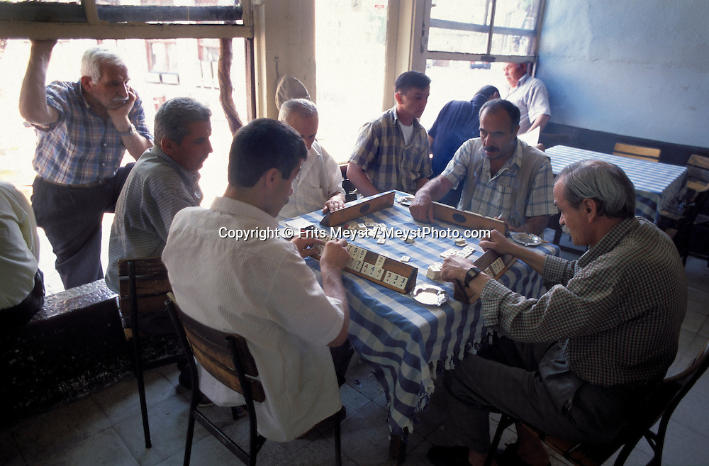 SAFRANBOLU, TURKEY AUGUST 2003. Turkish men play Okey in the local tea house. The city of Safranbolu positioned in the forests on the Black Sea coast is one of the world heritage sites of the UNESCO. Apart from its Ottoman era wood and mudbrick houses it is also known for its 'Lokum' or Turkish delight. A delicate sweets with flavours from nuts to rose petals. Photo by Frits Meyst/Adventure4ever.com