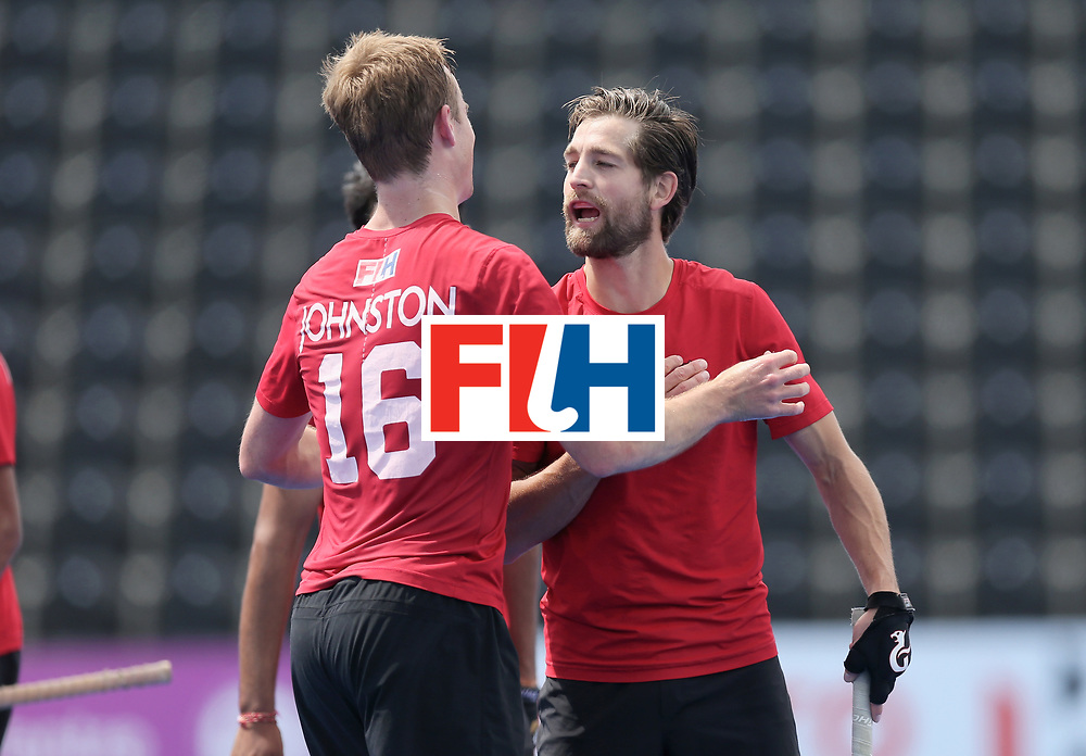 LONDON, ENGLAND - JUNE 25: Gordan Johnston of Canada and Iain Smythe of Canada embrace after the 5th/6th place match between India and Canada on day nine of the Hero Hockey World League Semi-Final at Lee Valley Hockey and Tennis Centre on June 25, 2017 in London, England. (Photo by Alex Morton/Getty Images)
