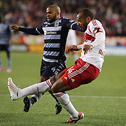 Thierry Henry, New York Red Bulls, shoots while challenged by Kevin Ellis, Sporting Kansas City, during the New York Red Bulls V Sporting Kansas City, Major League Soccer Play Off Match at Red Bull Arena, Harrison, New Jersey. USA. 30th October 2014. Photo Tim Clayton