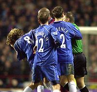 Photo. Richard Lane. <br />Aston Villa v Birmingham City. Barclaycard Premiership. 03/03/2003<br />Robbie Savage falls back after a Dion Dublin head butt.