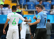 20th June 2018, Rostov on Don, Russia; 2018 World Cup Football;  Mohammed Alburayk (L) of Saudi Arabia passes a bottle of water to Cristian Rodriguez of Uruguay during a Group A match between Uruguay and Saudi Arabia at the 2018 FIFA World Cup