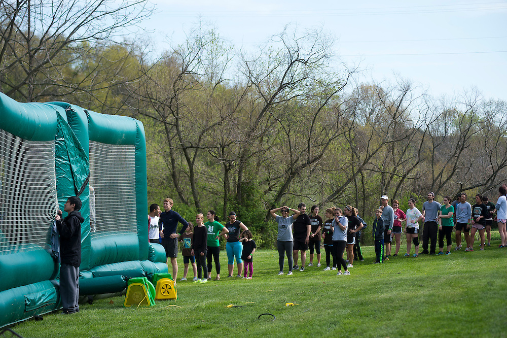 Participants of the O'bleness Health System Race for a Reason Mud Run wait in line to go through the inflatable obstacle course before they make it up the hill to the old Army ROTC training course at the Ridges, Saturday, April 27, 2013. The Mud Run was a four-mile run up to the ROTC Course, through the Radar Hill Trail and back to Tail Great Park across from Peden Stadium. Race for a Reason, Race 4 A Reason, Annual Events, Events, Students, Faculty & Staff