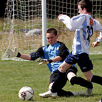 Clare's Adam Flemming makes the save during their soccer game against Salthill as part of the Lees Road open day on Sunday.<br /> <br /> <br /> <br /> Photograph by Yvonne Vaughan.
