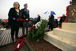 11 November 2018. Lochnagar Crater, La Boisselle, Somme, France. <br /> <br /> Gathered in the pouring rain, those who perished in the Great War are remembered by British and French civilians on the 100th anniversary of the Great War. <br /> <br /> Lochnagar Crater was created by the Tunnelling Companies of the Royal Engineers under a German field fortification. The explosion was the loudest man made noise created at that time, purportedly heard in London. <br /> <br /> Photo&copy;; Charlie Varley/varleypix.com