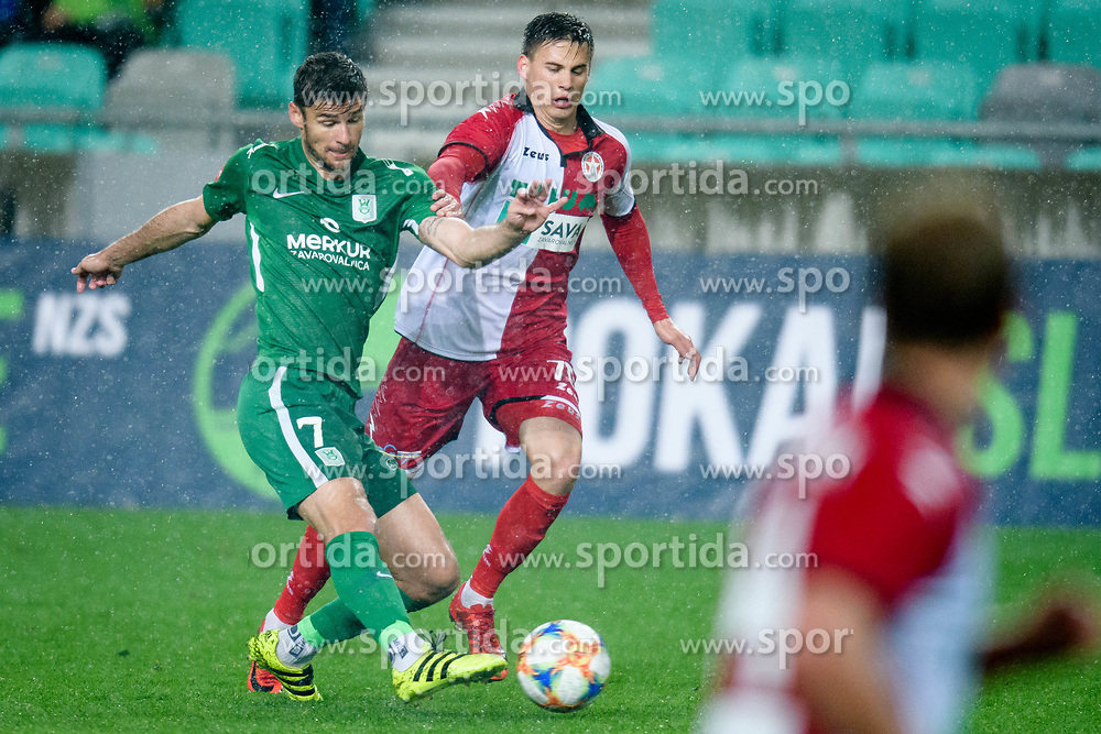 Rok Kronaveter, Kruno Ivancic during football match between NK Olimpija Ljubljana and NK Aluminij in semi final of Slovenian Cup 2018/19, on April 23, 2019 in Stozice Stadium, Ljubljana, Slovenia. Photo by Morgan Kristan