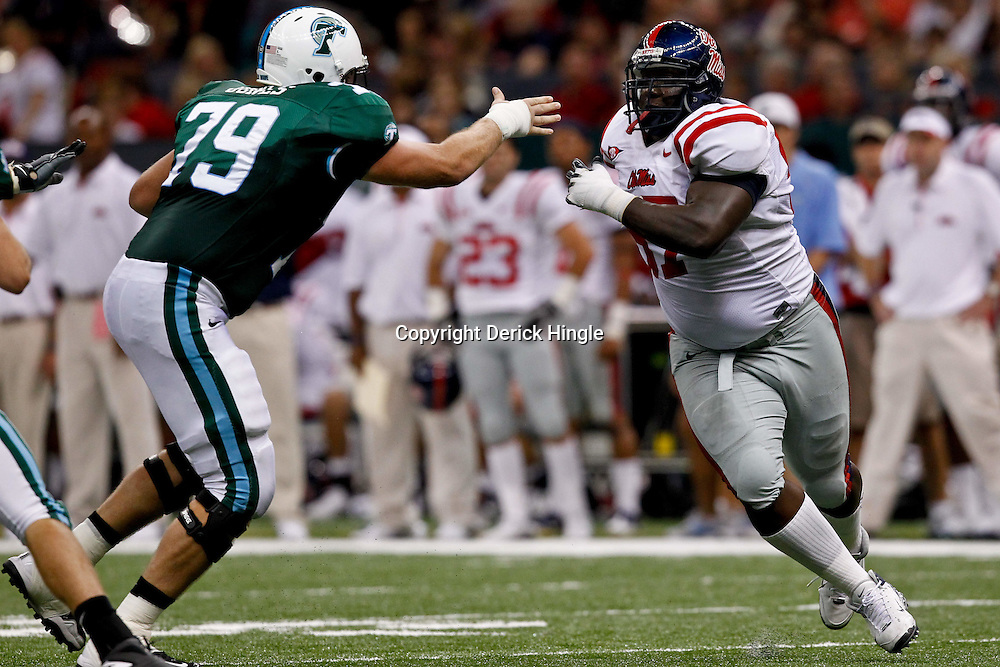Sep 11, 2010; New Orleans, LA, USA; Mississippi Rebels defensive tackle Jerrell Powe (57) rushes against Tulane Green Wave tackle Eric Jones (79)during a game at the Louisiana Superdome. The Mississippi Rebels defeated the Tulane Green Wave 27-13.  Mandatory Credit: Derick E. Hingle