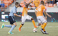 Jun 29, 2016; Houston, TX, USA; Houston Dynamo midfielder Oscar Garcia (27) dribbles against Sporting Kansas City midfielder Benny Feilhaber (10) in the second half at BBVA Compass Stadium. Dynamo won 3 to 1. Mandatory Credit: Thomas B. Shea-USA TODAY Sports