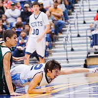 021513       Cable Hoover<br /> <br /> Window Rock Scout Kyler AShley (12) breaks away from Show Low Cougar Sean Potter (1) to reach after a loose ball during the Arizona State Basketball Tournament at the NAU Walkup Skydome in Flagstaff Friday.