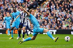 Harry Kane (ENG) of Tottenham Hotspur stretches to hit a shot - Photo mandatory by-line: Rogan Thomson/JMP - 07966 386802 - 12/04/2014 - SPORT - FOOTBALL - The Hawthorns Stadium - West Bromwich Albion v Tottenham Hotspur - Barclays Premier League.