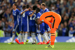 Adrian of West Ham United looks dejected as Eden Hazard of Chelsea celebrates scoring a goal from the penalty spot to make it 1-0 - Rogan Thomson/JMP - 15/08/2016 - FOOTBALL - Stamford Bridge Stadium - London, England - Chelsea v West Ham United - Premier League Opening Weekend.