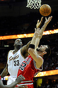 Apr 19, 2010; Cleveland, OH, USA; Cleveland Cavaliers center Shaquille O'Neal (33) tries to rebound over Chicago Bulls center Brad Miller (52) during the second period in game two in the first round of the 2010 NBA playoffs at Quicken Loans Arena. Mandatory Credit: Jason Miller-US PRESSWIRE