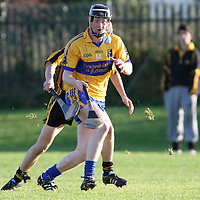 """Jamie Shanahan Sixmilebridge about to gater possession ahead of Jack Browne Ballyea in the Minor """"A"""" Hurling Final. - Photograph by Flann Howard"""