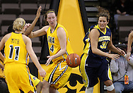 26 JANUARY 2009: Iowa center Megan Skouby (44) and Michigan guard/forward Carmen Reynolds (33) look at a lose ball during the first half of an NCAA women's college basketball game Monday, Jan. 26, 2009, at Carver-Hawkeye Arena in Iowa City, Iowa. Iowa defeated Michigan 77-69.