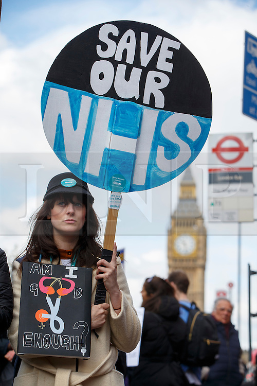 © Licensed to London News Pictures. 26/04/2016. London, UK. Junior doctors of St Thomas' Hospital protesting at a picket line as junior doctors in England stage a all-out 48-hours strike for the first time in NHS history in a dispute over pay, working hours and patient safety on Tuesday, 26 April 2016. Photo credit: Tolga Akmen/LNP