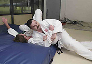 "Vince Ashcraft, from Piqua (right) trains with Russ Langston, from Piqua (left) during a judo class in the Miami County YMCA, Thursday, May 31st.  They use these 'crash mats' to practice full force throws.  Ashcraft says the landing is, ""like a featherbed."""