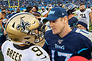 NASHVILLE, TN - DECEMBER 22:  Drew Brees #9 of the New Orleans Saints talks after the game with Ryan Tannehill #17 of the Tennessee Titans at Nissan Stadium on December 22, 2019 in Nashville, Tennessee. The Saints defeated the Titans 38-28.  (Photo by Wesley Hitt/Getty Images) *** Local Caption *** Drew Brees; Ryan Tannehill