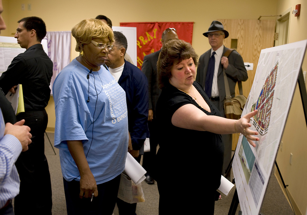 Anita Boehmer- Renner, (right) of Arlington, discusses one of the development options for the Mellon Arena with Elizabeth Ransom, (left) of the Hill District, at a Open House on Mellon Arena development  at Ebenezer Baptist Church in the Hill District. Boehmer-Renner works in concessions at the arena.