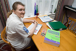 Nurse working on paperwork at home,