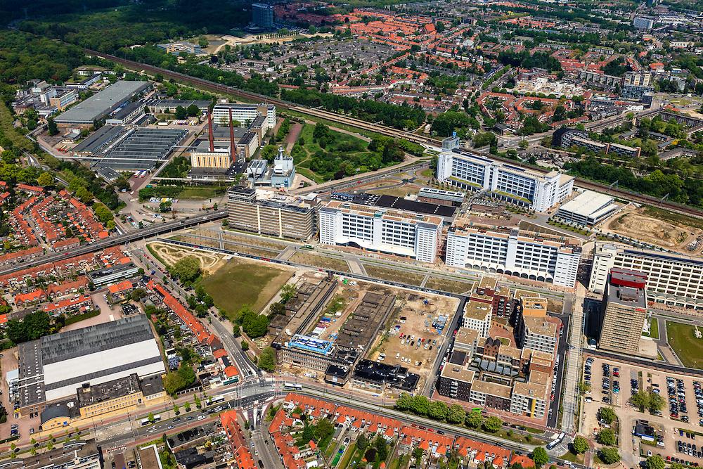 Nederland, Noord-Brabant, Eindhoven, 27-05-2013; Strijp-S, voormalige Philipsterrein, was niet toegankelijk voor het publiek, 'de verboden stad'. Het gebied, met diverse Rijksmonumenten, wordt ontwikkeld voor wonen, werken en cultuur.<br /> <br /> Boven in beeld Philitefabriek met Klokgebouw (Strijp S), in het midden het Veemgebouw met daar direct naast De Hoge (Witte) Rug. Meer onder in beeld, in baksteen het voormalige NatLab. <br /> <br /> Strijp-S, former Philips area, was not accessible to the public, 'the forbidden city'. The area, with several national monuments, is designated for living, working and culture.<br /> <br /> Top image Philitefabriek / Clock Building (Strijp S), in the middle of the Veemgebouw next to the High (White) Back. Bottom in the former NatLab (brick building). <br /> <br /> luchtfoto (toeslag op standard tarieven);<br /> aerial photo (additional fee required);<br /> copyright foto/photo Siebe Swart