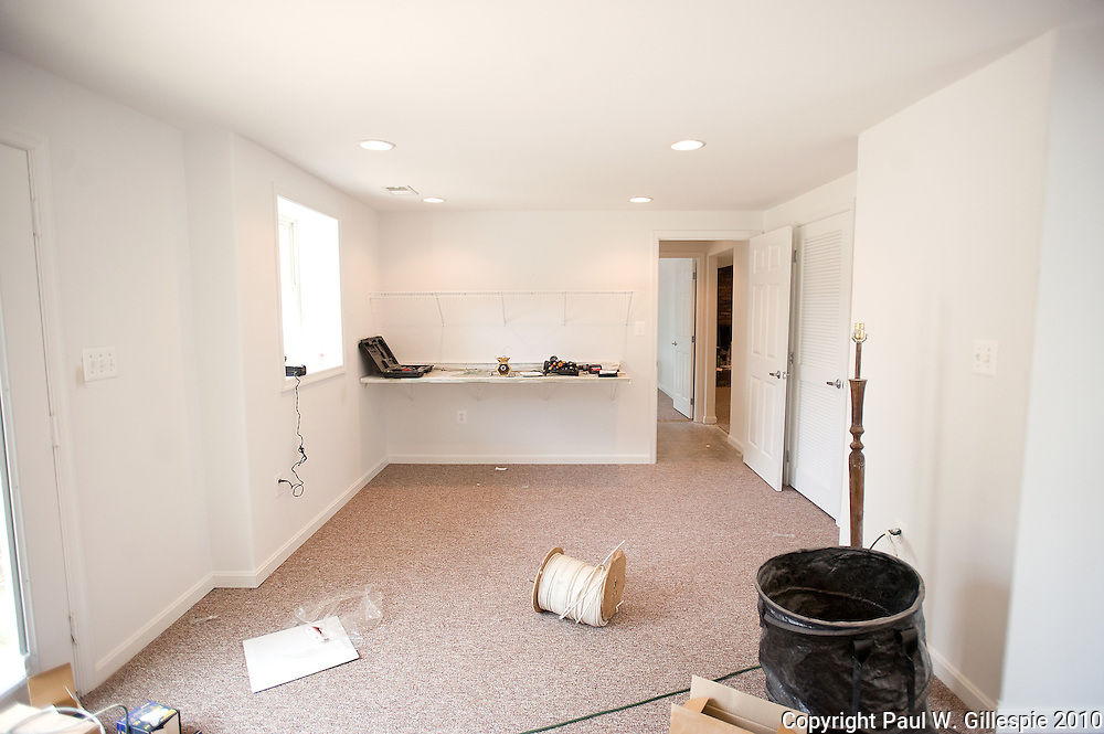 Contractors work on remodeling the Barry home. The Barry family, residing in the Four Seasons development near Gambrills in the western part of Anne Arundel County, has been selected as the second recipient of the MARYLAND HOME MAKEOVERª.  (Photo by Paul W Gillespie) 8/17/10