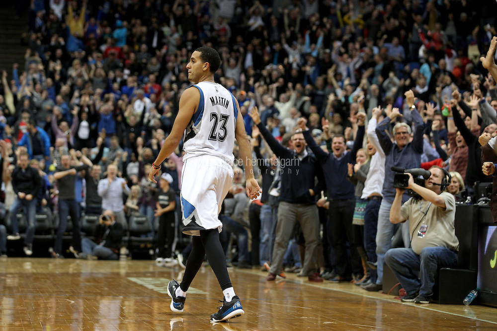 Nov 1, 2014; Minneapolis, MN, USA; Minnesota Timberwolves guard Kevin Martin (23) celebrates during the fourth quarter against the Chicago Bulls at Target Center. The Bulls defeated the Timberwolves 106-105. Mandatory Credit: Brace Hemmelgarn-USA TODAY Sports