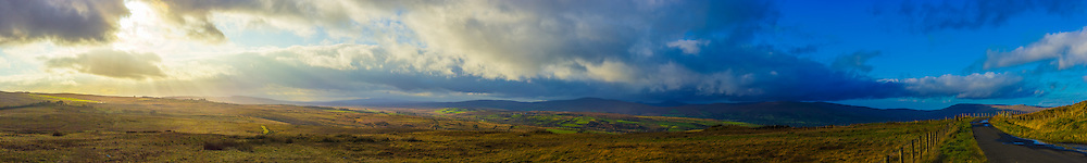 180 degree view from Straw Mountain on the shoulders of Slieve Gallion in the Sperrin Mountains spanning from Davagh Forest on the left, passed Mullaghaneany, Oughtmore, Crockmore, Crockback and finally through to Mullaghmore on the right and the road onwards to the Northern Sperrins. <br /> <br /> Image made up of 15 photos at 50mm in portrait orientation. You can zoom in and take a closer look to see what this could look like on your wall here http://adambrooks.photoshelter.com/#!/p/I0000OO3Q9B0lRhI<br /> <br /> Available in sizes ranging from 8&quot;x52&quot; - 16&quot;x104&quot; (20cmx132cm - 41cmx264cm).