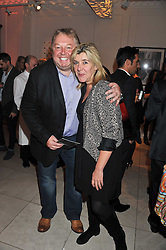 NICK FERRARI and SIOBHAN WYKES at a reception to celebrate the publication of Candy and Candy: The Art of Design held at the Halcyon Gallery, 24 Bruton Street, London W1 on 26th October 2011.
