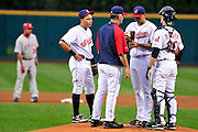 Sept. 15, 2010; Cleveland, OH, USA;  Cleveland Indians shortstop Asdrubal Cabrera (13) pitching coach Tim Belcher (49) and catcher Lou Marson (30) talk with Cleveland Indians starting pitcher Jeanmar Gomez (58) who gave up four runs during the first inning  against the Los Angeles Angels at Progressive Field. Mandatory Credit: Jason Miller-US PRESSWIRE