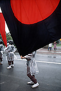 July 29, 2003, Tokyo, Tokyo, Japan: Photo taken: July 24, 2003<br /> Photo by: Torin Boyd<br /> <br /> Photo shows boys dressed in samurai armor costumes, loading flags and banners into a truck at the end of the days festivities.<br /> <br /> Further info:<br /> <br /> In Japan&rsquo;s Fukushima Prefecture, there has been a festival taking place for over a thousand years that celebrates a wild horse chase. Called the Soma Noma Oi, this festival is held in late July, and takes place in the cities of Soma and Haramachi. It is considered one of Japan&rsquo;s foremost festivals. <br /> <br /> During the four day event, over six hundred riders and horses take part in series of events that pays tribute to samurai equestrian arts. Originated during the Heian Period (769 - 1185), this local culture began when warriors of the Soma clan began herding wild horses as military training, in preparation for war. Nowadays, this festival is held in order to preserve the traditional and cultural aspects of this martial art.<br /> <br /> Photo shows the second day of the festival which took place in Haramachi, where races were held, as well as the main event, the contest of the sacred banner. During this event riders in full armor regalia with ancestral flagstaffs jockey to catch one of forty banners fired individually into the air by fireworks. This event resembles a battle during the old warring states period of Japan. When the banner falls to the ground, hundreds of riders scramble to catch it. Upon catching the banner, the victorious rider gallops his horse to a shrine situated above the riding grounds to receive a blessing.<br /> <br /> Prior to the sporting events, the riders parade through the city of Haramachi where spectators cheer them on.<br /> <br /> . Credit: Torin Boyd / Polaris