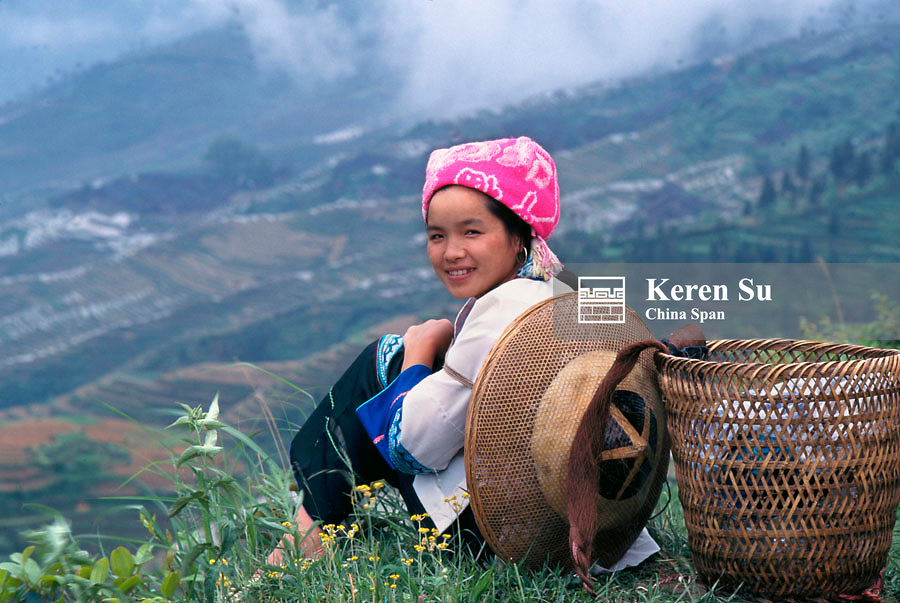 Zhuang girl with terraced rice paddies in the mountain, Longsheng, Guangxi Province, China