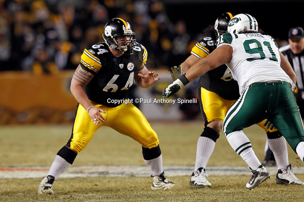 Pittsburgh Steelers center Doug Legursky (64) pass blocks in relief of Pittsburgh Steelers center Maurkice Pouncey (53) who left the game with an injury during the NFL 2011 AFC Championship playoff football game against the New York Jets on Sunday, January 23, 2011 in Pittsburgh, Pennsylvania. The Steelers won the game 24-19. (©Paul Anthony Spinelli)