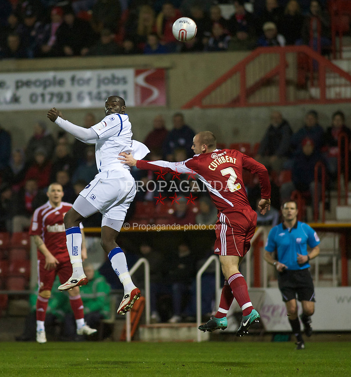 SWINDON, ENGLAND - Tuesday, January 25, 2011: Tranmere Rovers' Enoch Showunmi and Swindon Town's Scott Cuthbert challenge for the ball in the air during the Football League One match at the County Ground. (Photo by Gareth Davies/Propaganda)