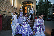 Performers leave a venue after a traditional Kazakh wedding, in Astana, Kazakhstan.
