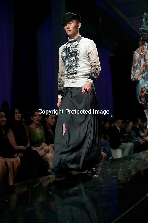 BEIJING, MAY 11, 2012 : models walk down a catwalk during a Jean-Paul Gaultier fashion  show in Beijing.